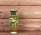 Chinese vase on a wooden background — 图库照片