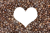 Background of coffee beans with heart — Stock Photo