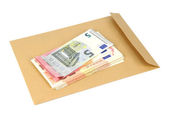 Envelope and money on a white background — Stock Photo