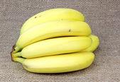 Fresh ripe tasty bananas on canvas — Stock Photo
