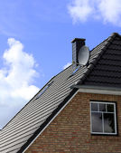 The roof of the house with nice window — Stock Photo