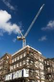 Building Rennovating with crane and scaffolding — Stock Photo