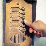 Finger ringing a door bell — Stock Photo #63427525
