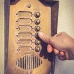 Finger ringing a door bell vintage — Stock Photo #63429703