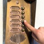 Ringing a door bell — Stock Photo #63832891