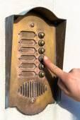 Ringing a door bell — Stock Photo