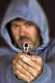 Thief or gang member holding a handgun — Stock Photo