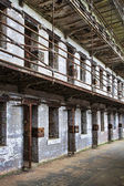 Cell block of the inside of an old prison — Stock Photo