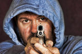 Thief or gang member holding a handgun — Stock Photo