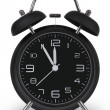 Black alarm clock with hands at 5 minutes till 12 — Stock Photo #58316649