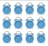 Twelve alarm clocks at the top of the hour — Stock Photo
