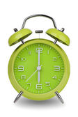 Green alarm clock with hands at 6 am or pm — Stock Photo