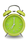 Green alarm clock with hands at 7 am or pm — Stock Photo