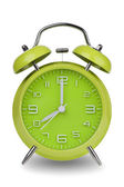 Green alarm clock with hands at 8 am or pm — Stock Photo
