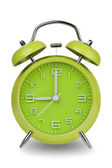 Green alarm clock with hands at 9 am or pm — Stock Photo