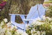 Impressionist art of a relaxing wooden blue swing with azaleas — Stock Photo