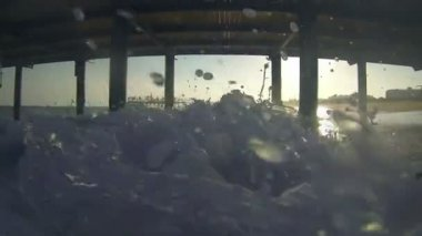 Waves Crashing Under Pier — Stok video