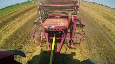Hay baler working in field — Stockvideo
