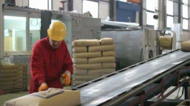 Warehouse worker in overalls — Stock Video