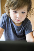 Toddler and laptop — Stock Photo