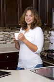Woman in the kitchen — Stock Photo