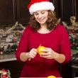 Woman peeling orange — Stock Photo #57274921