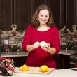 Woman peeling orange — Stock Photo #57275635