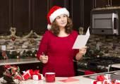 Woman writing Christmas card — Stock Photo