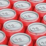 Red drink metallic cans, top view — Foto de Stock   #78551558
