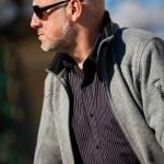 Stylish man in sunglasses enjoying the sun — Stock Photo #52676955