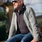 Stylish man in sunglasses enjoying the sun — Stock Photo #52676981