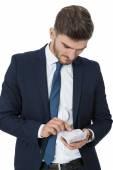 Successful businessman burning money — Stock Photo