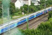 Fast moving train with blue stripe — Stok fotoğraf
