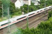 Fast moving train with red stripe — Stok fotoğraf