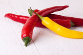 Fresh red and yellow chili peppers — Stock Photo