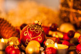 Warm gold and red Christmas candlelight background — Stock Photo