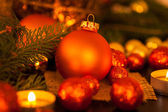 Warm gold and red Christmas candlelight background — Foto Stock