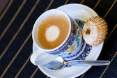 Cup of freshly brewed tea and a cookie — Foto Stock