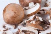 Diced and whole agaricus brown button mushrooms — Stock Photo