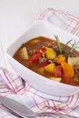 Hearty Stew in Bowl and Spoon — Stock Photo