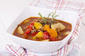 Hearty Stew in Bowl on Plaid Dish Towel — Stock Photo