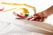 Hand Cutting Cloth with Scissors — Stock Photo