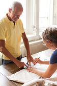Senior couple Cutting Cloth with Scissors — Stock Photo