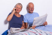 Senior Couple with Newspapers — Stock Photo
