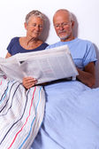 Senior Couple with Newspaper — Stock Photo