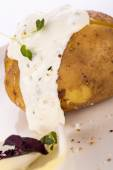 Baked jacket potato with sour cream sauce — Foto Stock