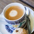 Cup of freshly brewed tea and a cookie — Stock Photo #54161173