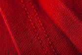 Texture of luxurious red fabric — Stock Photo