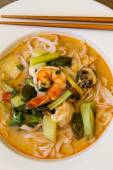 Bowl of traditional Thai tom yam soup — Stock Photo
