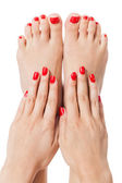 Woman with beautiful red finger and toenails — Stock Photo